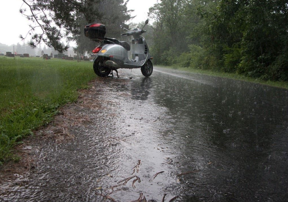 Riding a Vespa in the Rain